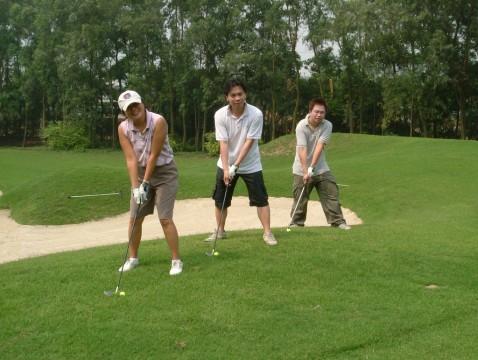 Trois joueurs de golf chinois